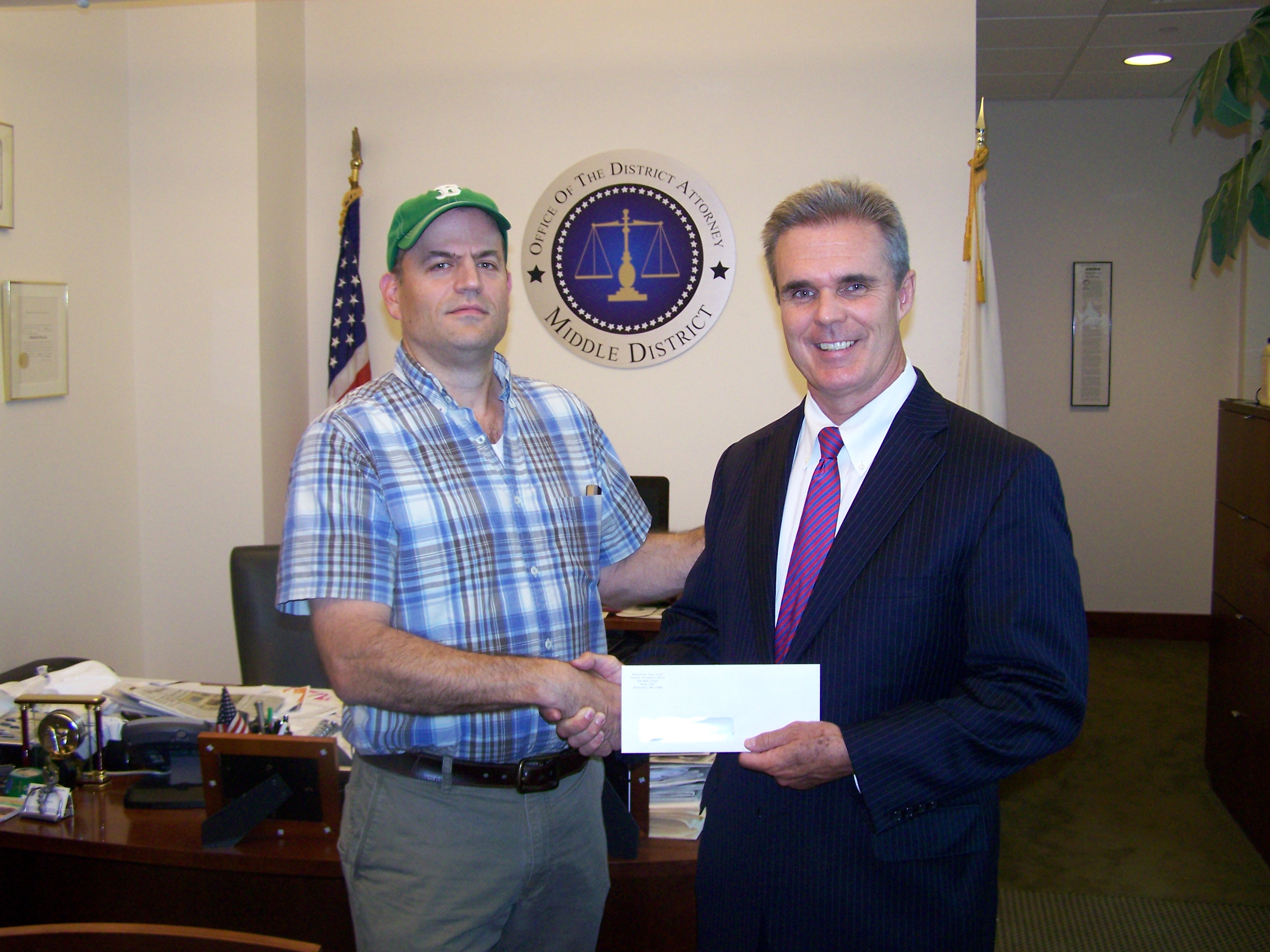 DA Early presents a check to Eric Rich of Tris Speaker Little League.