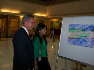 DA Early and Assistant DA Sara Khan look at a painting made by a juvenile offender. DA Early supports the Juvenile Court Art Program with Drug Forfeiture funds.