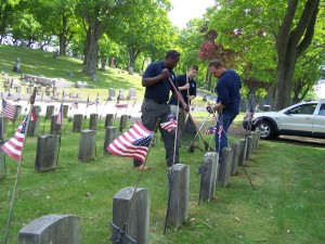 Members of the Diversion Program staff clean up the G.A.R. Veterans section in preparation for Memorial Day 2013.