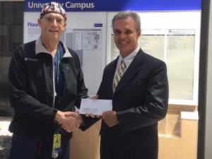 DA Early presents funds to Dr. Michael Hirsh to support the recent gun buyback program in Worcester.