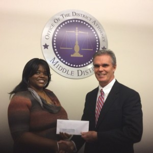 DA Early presents a check to Chantel Bethea of Women in Action.