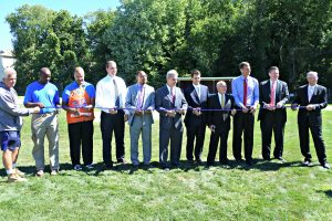 "District Attorney Early with representatives from Commerce Bank, including Chairman David ""Duddie"" Massad, Home Depot Store Manager Pedro Figueroa, Athletic Director for the Worcester Public Schools David Shea, Worcester City Manager Edward Augustus Jr., Worcester County Sheriff Lew Evangelidis and City Councilor Khrystian King to cut the ribbon on the newly renovated Commerce Bank Field behind Foley Stadium."