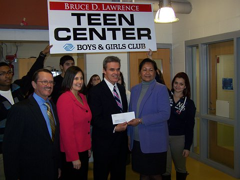 DA Early presents a check to the Boys and Girls Club of Leominster.