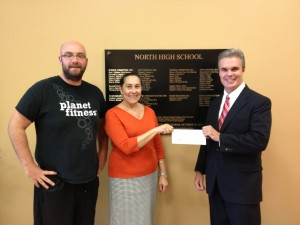 DA Early presents Drug Forfeiture funds to North High Principal Lisa Dyer and football coach Dan Boyle.