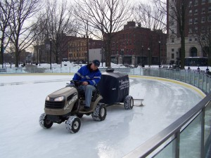 A worker prepares the Oval behind City Hall for skating with the Bambini, which was purchased with Drug Forfeiture funds and donated to the City of Worcester.